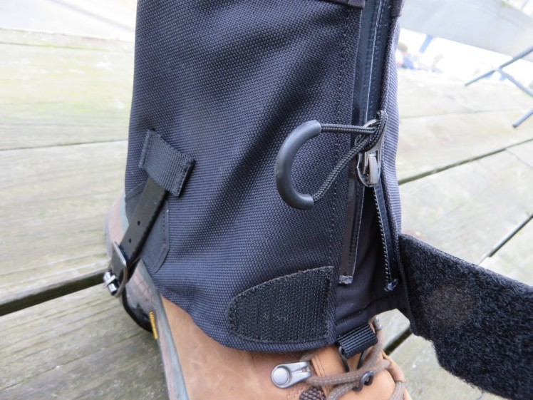 An easy zip paired with Velcrow to attach them, with a handy lace hook to keep them down.